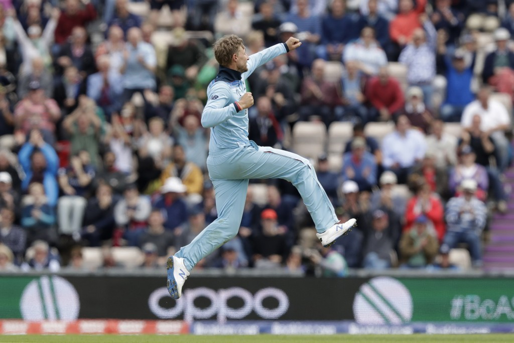 England's Joe Root celebrates taking the wicket of West Indies' captain Jason Holder during the Cricket World Cup match between England and West Indie...