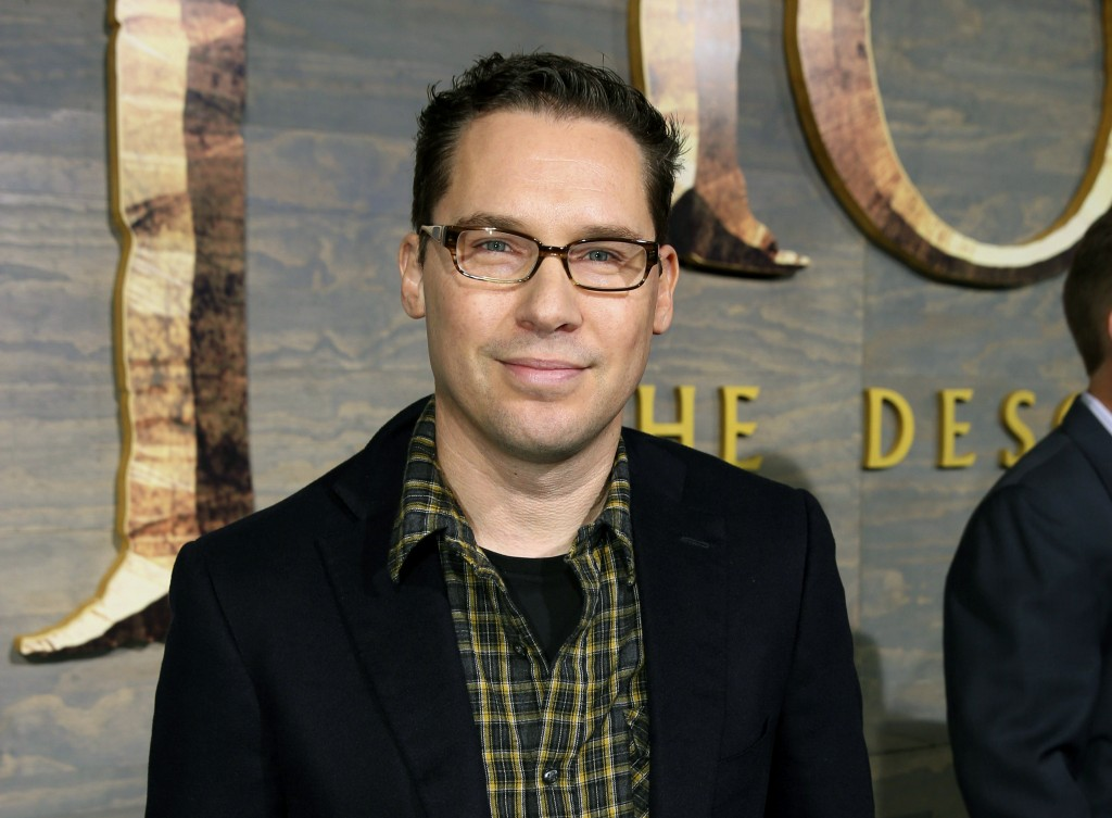 "FILE - This Dec. 2, 2013, file photo, shows Bryan Singer at the Los Angeles premiere of ""The Hobbit: The Desolation of Smaug.""   Singer has agreed to ..."