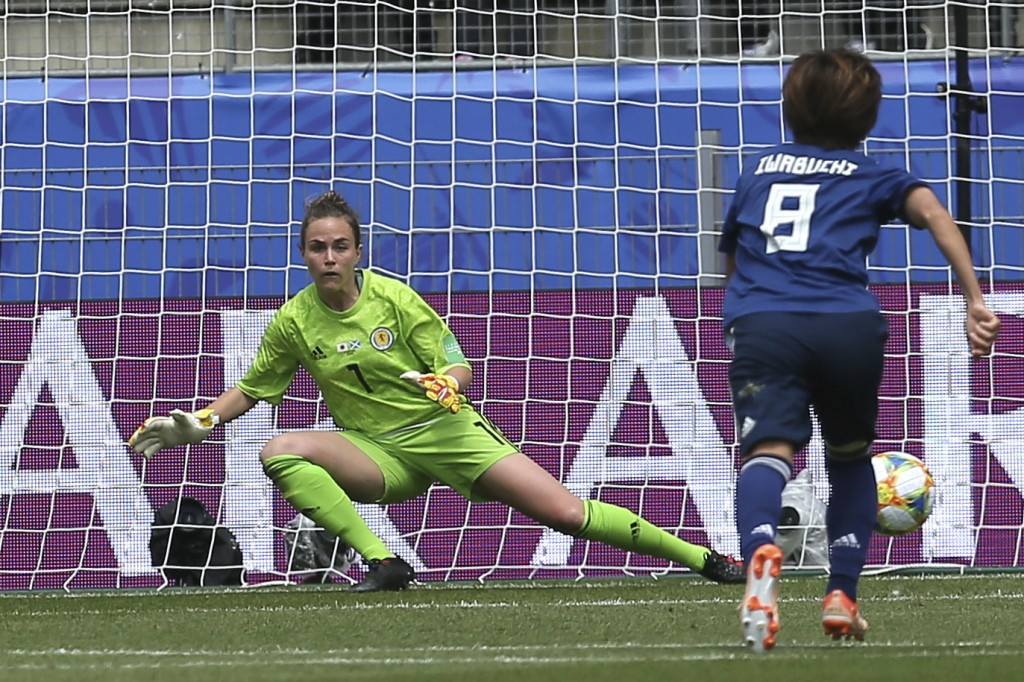 CORRECTING PLAYER NAME OF SCORER AND NUMBER OF GOAL - Japan's Mana Iwabuchi, right, on her way to score the first goal of the match during the Women's