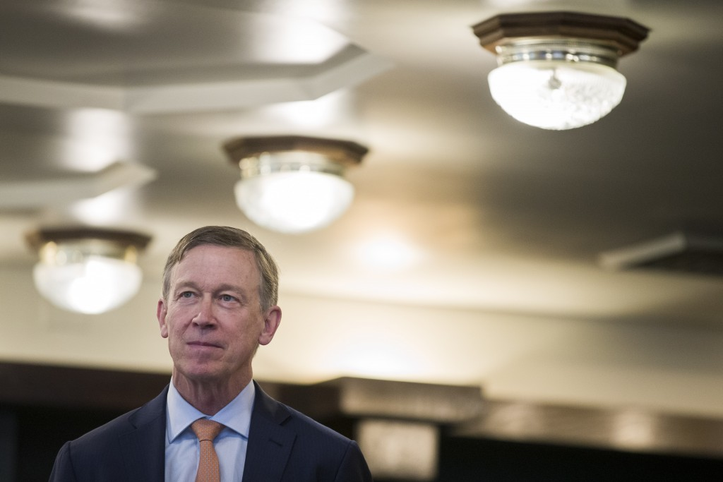 Former Colorado Governor John Hickenlooper waits as he is introduced before speaking during a media availability at the National Press Club, Thursday,