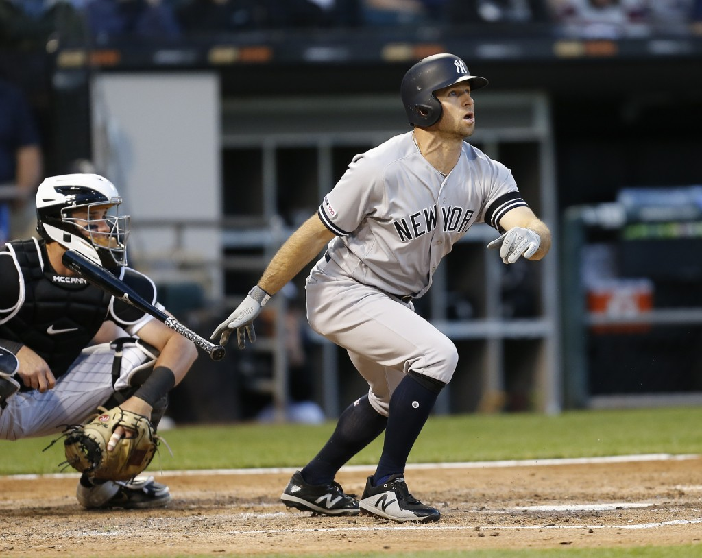 New York Yankees' Brett Gardner watches his two-run home run against the Chicago White Sox during the fourth inning of a baseball game Thursday, June