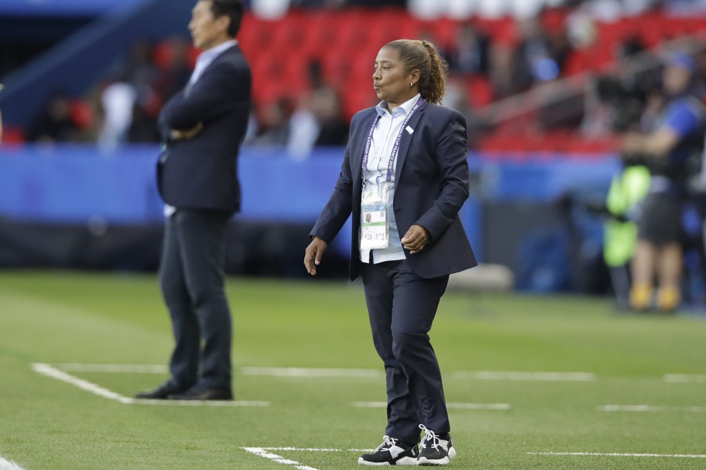 South Africa coach Desiree Ellis, right, and China...
