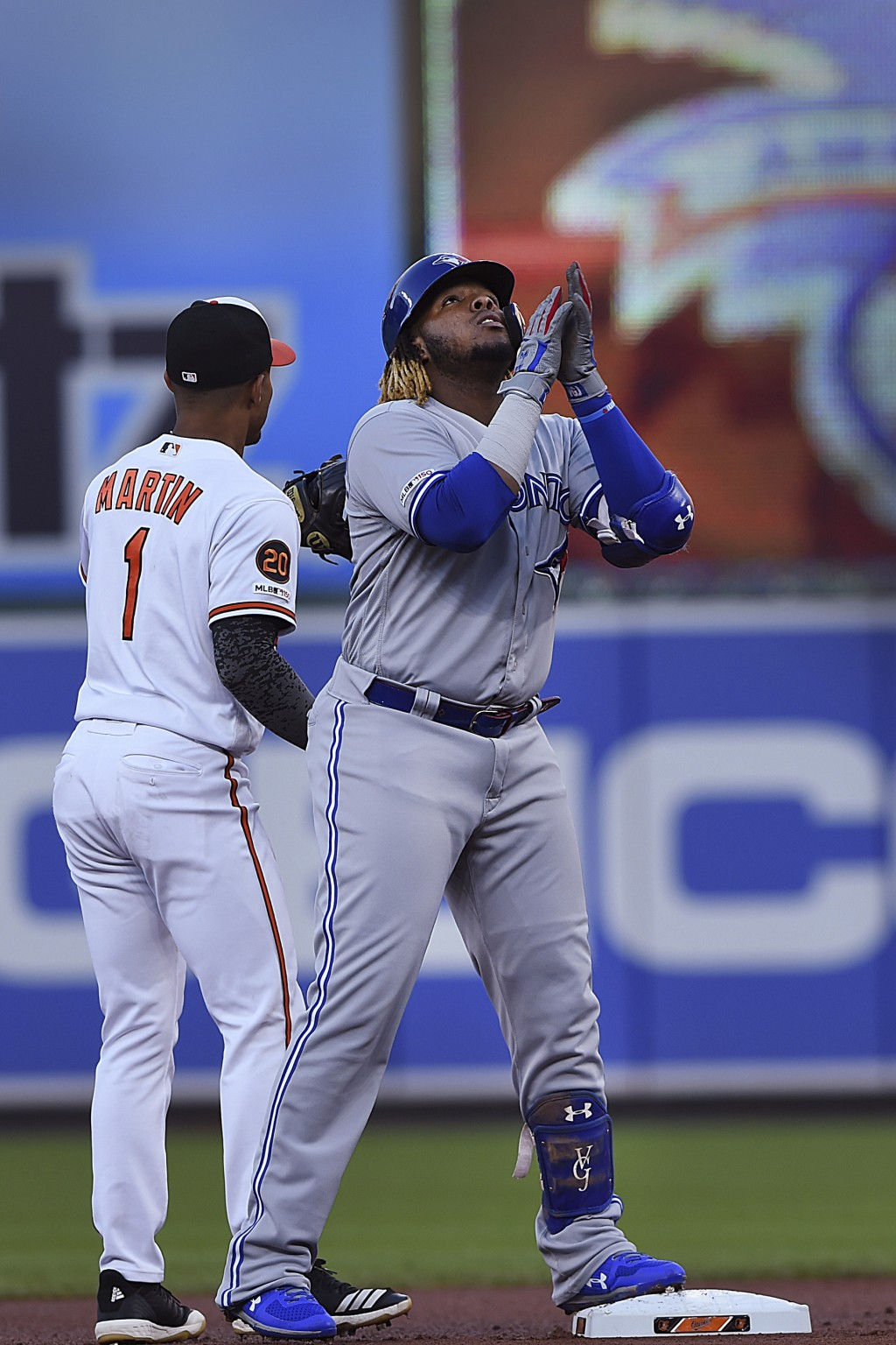 Toronto Blue Jays' Vladimir Guerrero reacts after hitting a double against the Baltimore Orioles during the first inning of a baseball game Thursday,