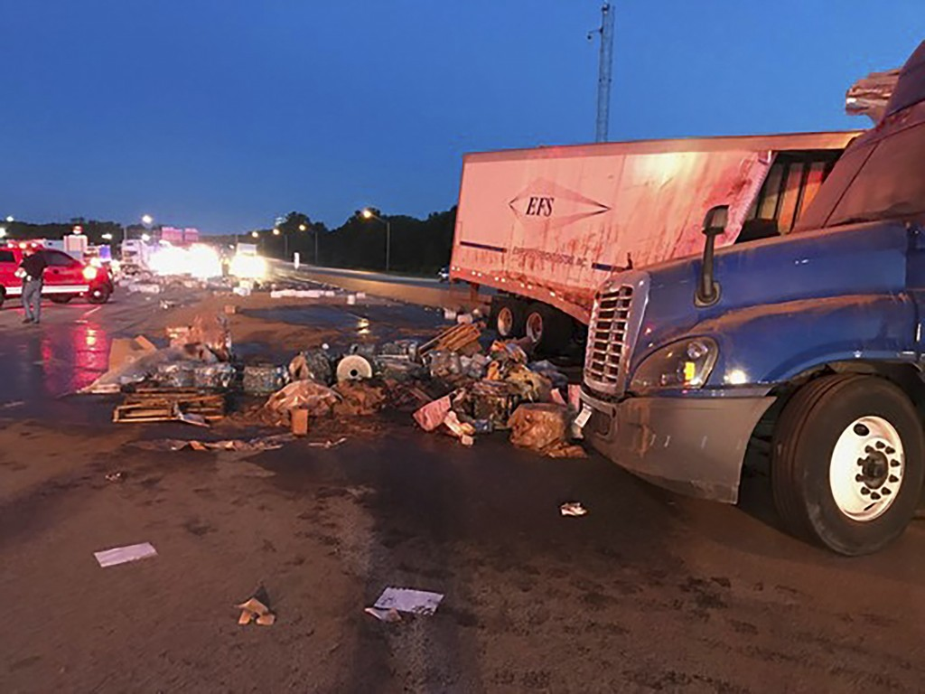This Friday, June 14, 2019 photo released by Indiana State Police shows a scene of a crash involving two semi-trucks closed a stretch of freeway in no