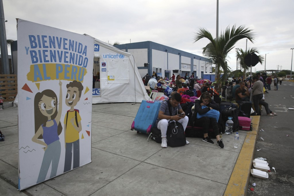 Venezuelan migrants wait another group of migrants to continue their travel to Lima  in Tumbes, Peru, Friday, June 14, 2019. Venezuelan citizens are r
