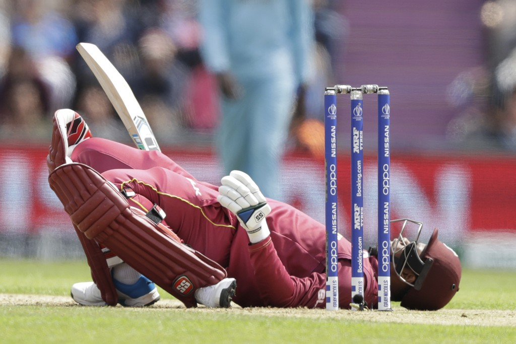 West Indies' Shimron Hetmyer lies back on the pitch after ducking a bouncer during the Cricket World Cup match between England and West Indies at the ...