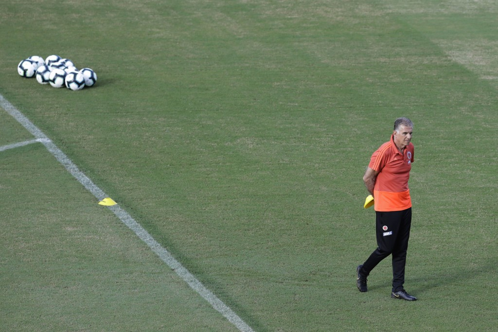 Colombia national soccer team coach Carlos Queiroz, walks during a training session, in Pituacu stadium, Salvador, Brazil, Thursday, June 13, 2019. On