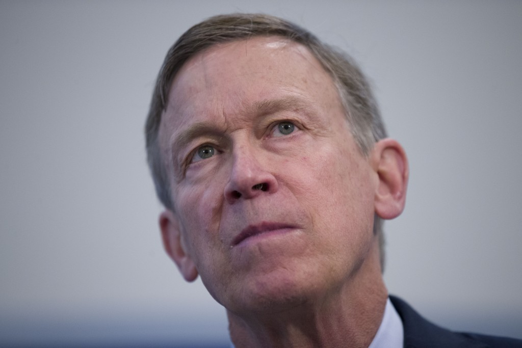 Former Colorado Governor John Hickenlooper listens to a question during a media availability at the National Press Club, Thursday, June 13, 2019, in W...
