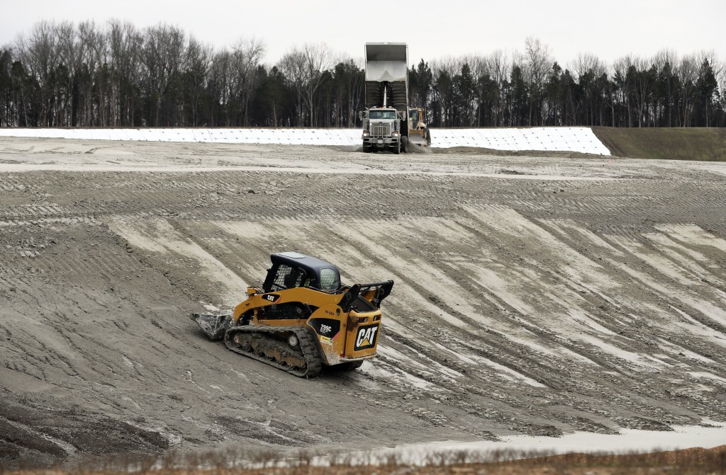FILE - In this Jan. 25, 2017 file photo, heavy equipment is used at an ash storage site at Gallatin Fossil Plant in Gallatin, Tenn. The nation's large