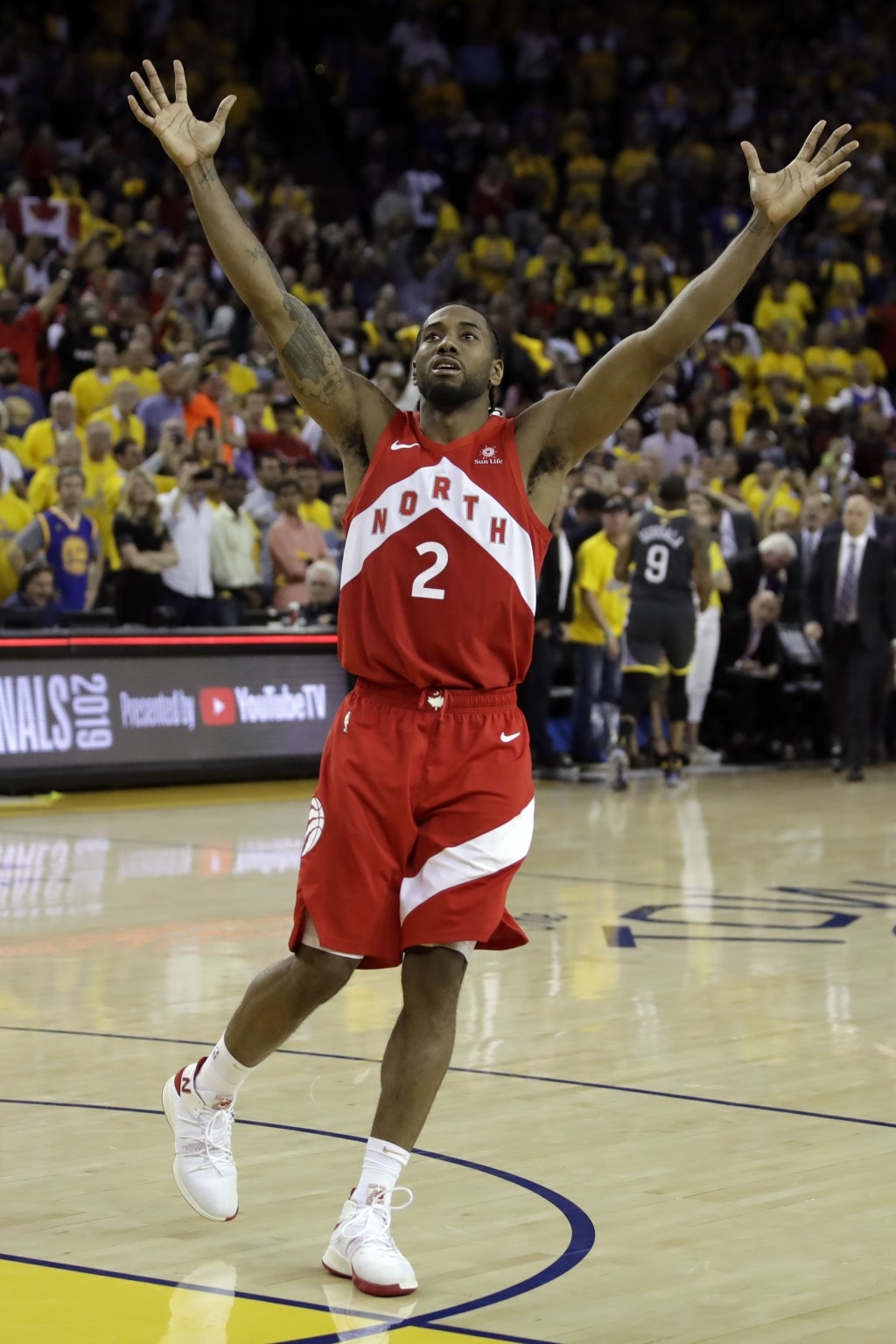 Toronto Raptors forward Kawhi Leonard celebrates after the Raptors defeat the Golden State Warriors 114-110 in Game 6 of basketball's NBA Finals in Oa