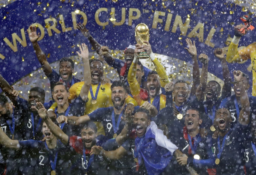 FILE - In this July 15, 2018, file photo, France goalkeeper Hugo Lloris holds the trophy aloft after the final match between France and Croatia at the