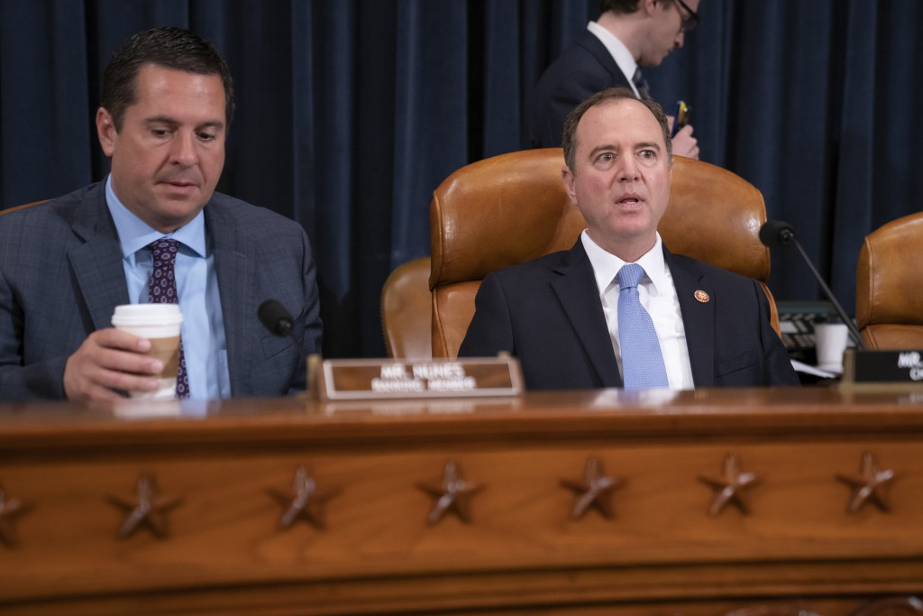 House Intelligence Committee Chairman Adam Schiff, D-Calif., right, joined by Rep. Devin Nunes, R-Calif, left, the ranking member, opens a hearing on