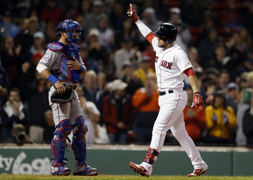 Boston Red Sox's Michael Chavis, right, celebrates his solo home run in front of Texas Rangers' Jeff Mathis during the fourth inning of a baseball gam
