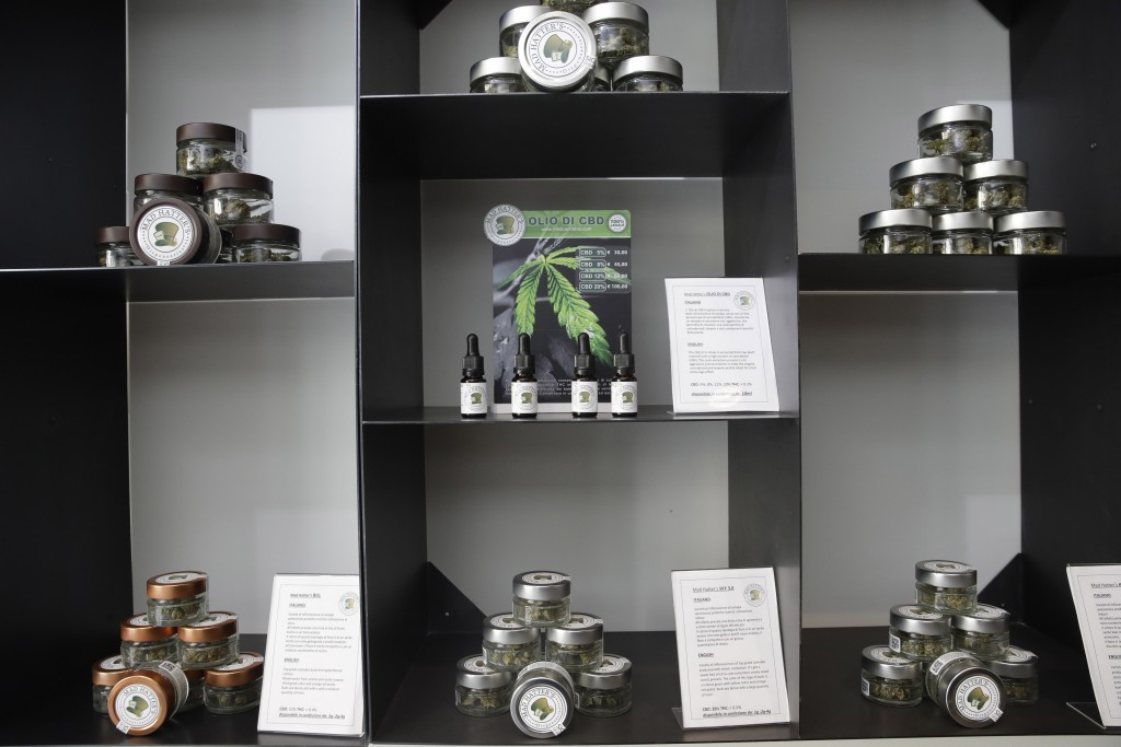 In this Thursday, June 6, 2019 photo, cannabis buds and products are displayed at a cannabis light store in Milan, Italy. Interior Minister Matteo Sal...