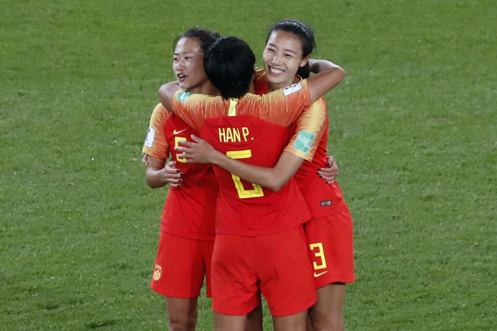China's Wu Haiyan, China's Han Peng, and China's Lin Yuping, from left to right, celebrate their 1-0 win at the end of the Women's World Cup Group B s