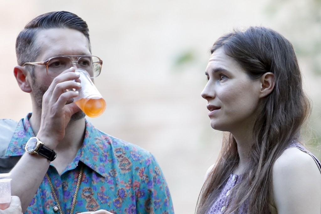 Amanda Knox, right, and her boyfriend Christopher Robinson attend a cocktail for the opening of the Innocence Project conference, in Modena, Italy, Th...