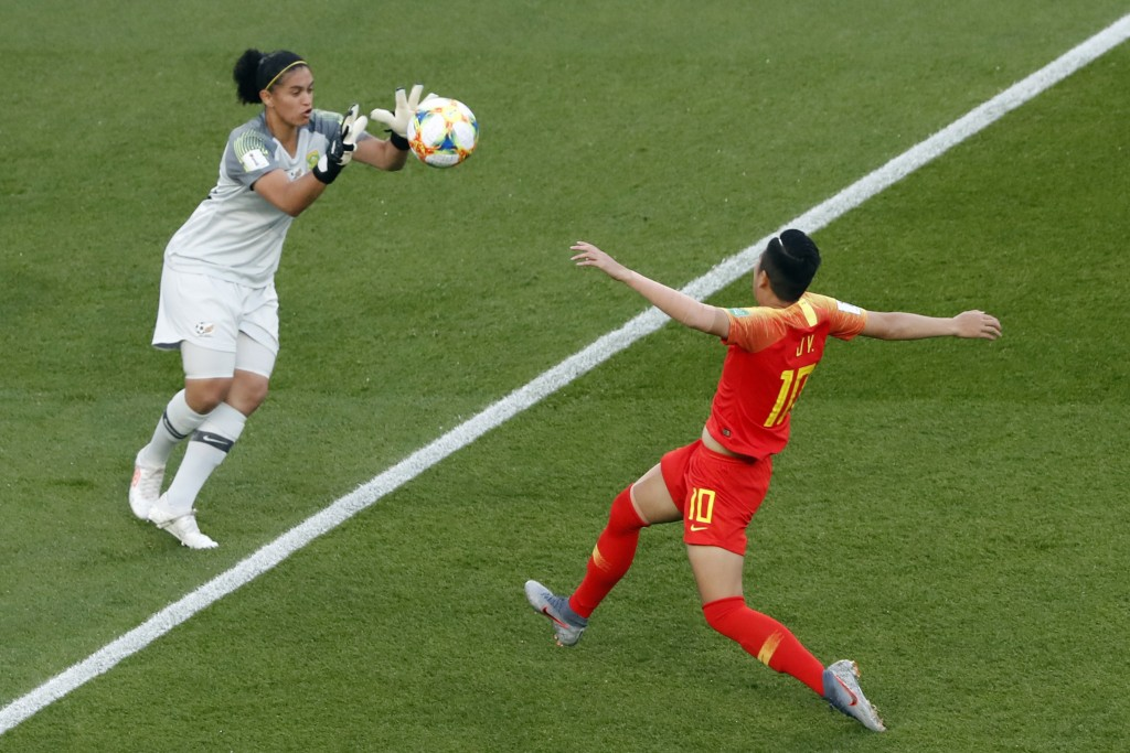 China's Li Ying, right, challenges for the ball with South Africa goalkeeper Kaylin Swart during the Women's World Cup Group B soccer match between Ch
