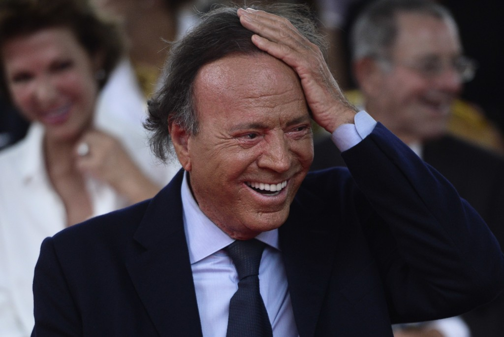 FILE - In this Sept. 29, 2016 file photo, Spain's singer Julio Iglesias smiles during his star unveiling ceremony at the Walk of Fame in San Juan, Pue...