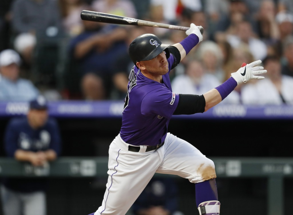 Colorado Rockies' Trevor Story watches his two-run home run off San Diego Padres starting pitcher Matt Strahm during the second inning of a baseball g