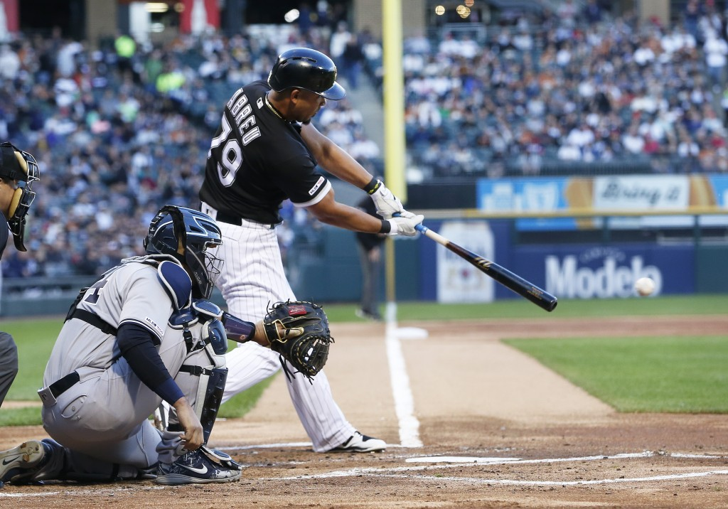 Chicago White Sox's Jose Abreu hits a single against the New York Yankees during the first inning of a baseball game Thursday, June 13, 2019, in Chica
