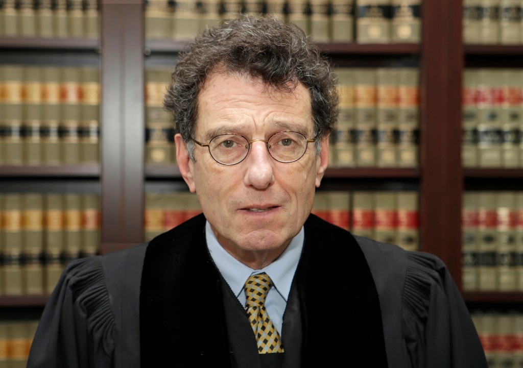 FILE – In this Jan. 11, 2018, file photo, U.S. District Judge Dan Polster poses for a portrait in his office in Cleveland. Polster He has ruled that l
