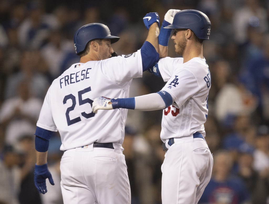 Los Angeles Dodgers' Cody Bellinger, right, celebrates his two-run home run with David Freese during the fourth inning of a baseball game against the