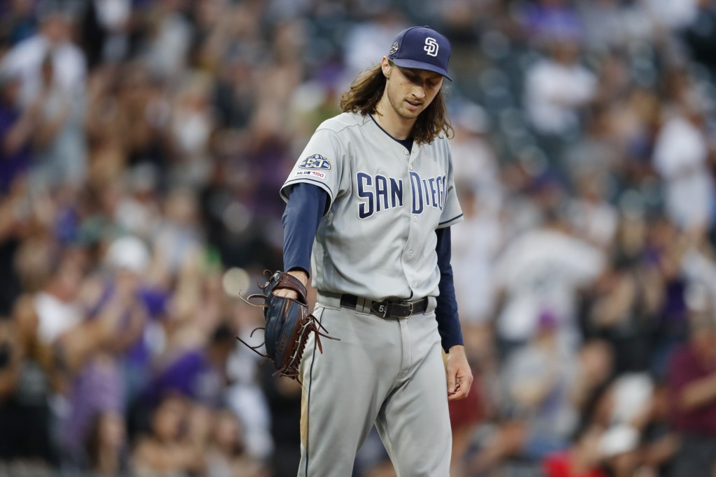 San Diego Padres starting pitcher Matt Strahm reacts after giving up a two-run home run to Colorado Rockies' Trevor Story during the second inning of