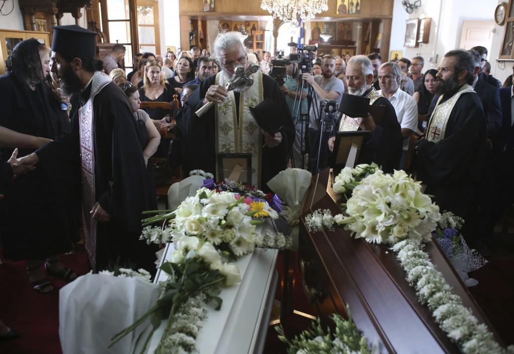 Greek Orthodox Christian clergymen preside over the funeral of Livia Florentian Bunea, 36, from Romania and her eight year-old daughter Elena Natalia ...