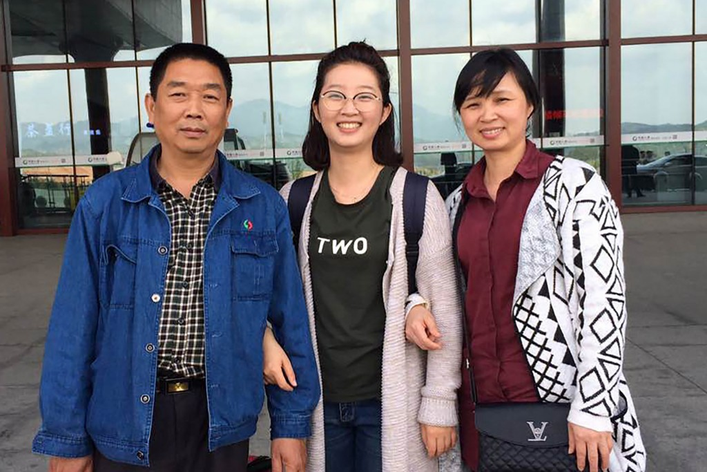 FILE - This 2017 file photo provided by Xinyang Zhang shows his sister, Yingying, with their parents, Ronggao Zhang, right, and Lifeng Ye, at a train ...
