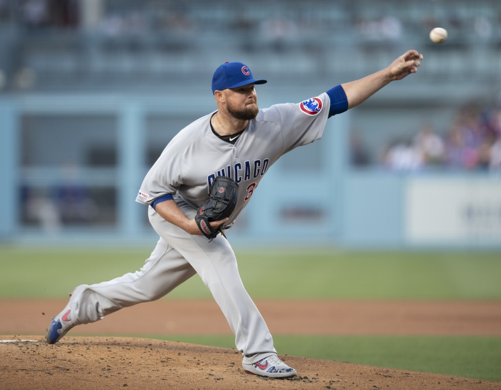 Chicago Cubs starting pitcher Jon Lester throws during the first inning of the team's baseball game against the Los Angeles Dodgers in Los Angeles, Th