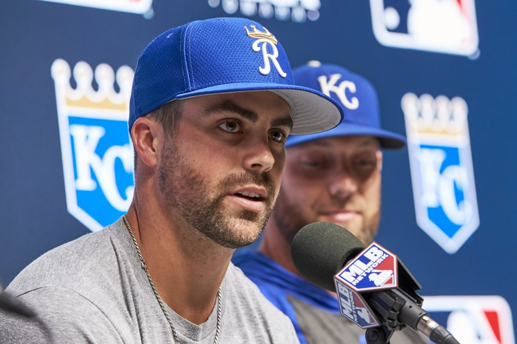 Kansas City Royals' Whit Merrifield, left, speaks in front of Alex Gordon, during a news conference ahead of a baseball game between the Detroit Tiger
