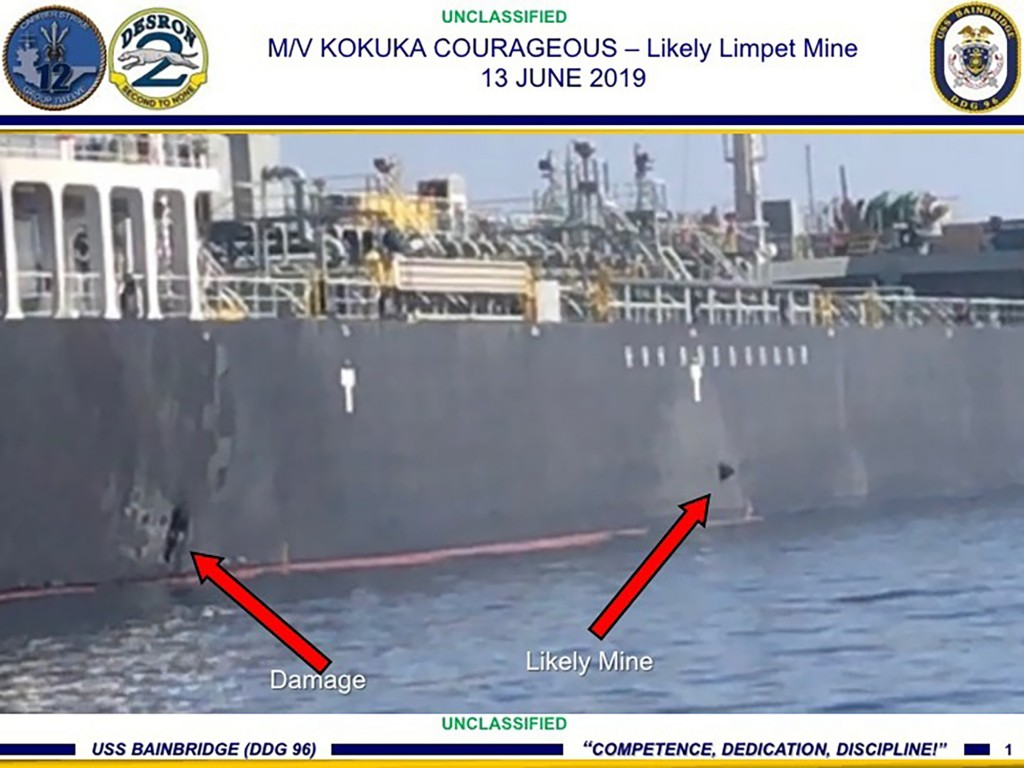 This June 13, 2019, image released by the U.S. military's Central Command, shows damage and a suspected mine on the Kokuka Courageous in the Gulf of O...