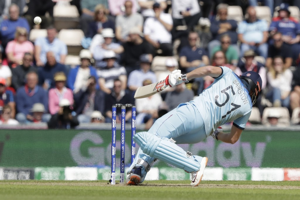 England's Jonny Bairstow ducks a bouncer from West Indies' Andre Russell during the Cricket World Cup match between England and West Indies at the Ham...