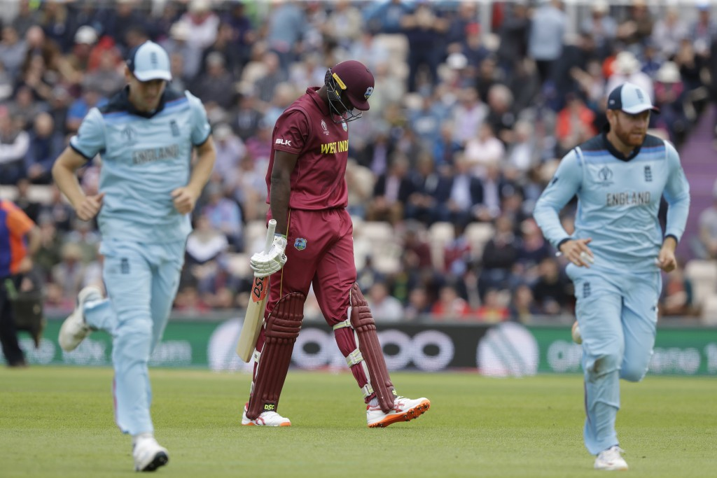 West Indies' captain Jason Holder walks off the field of play after losing his wicket from the bowling of England's Joe Root during the Cricket World ...