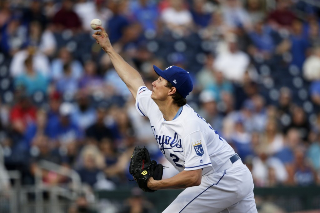 Kansas City Royals starting pitcher Homer Bailey works against the Detroit Tigers during the first inning of a baseball game in Omaha, Neb., Thursday,...