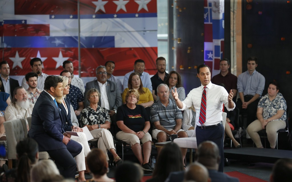 Democratic presidential candidate Julian Castro, right, answers a question during a FOX News Channel town hall event, Thursday, June 13, 2019, in Temp
