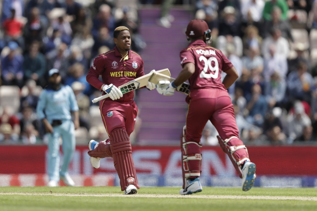 West Indies' Shimron Hetmyer, left, and West Indies' Nicholas Pooran adds runs during the Cricket World Cup match between England and West Indies at t...