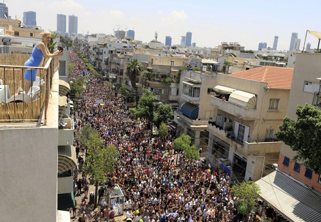 People take part in annual Gay Pride parade in Tel Aviv, Israel, Friday, June 14, 2019.(AP Photo/Tsafrir Abayov)