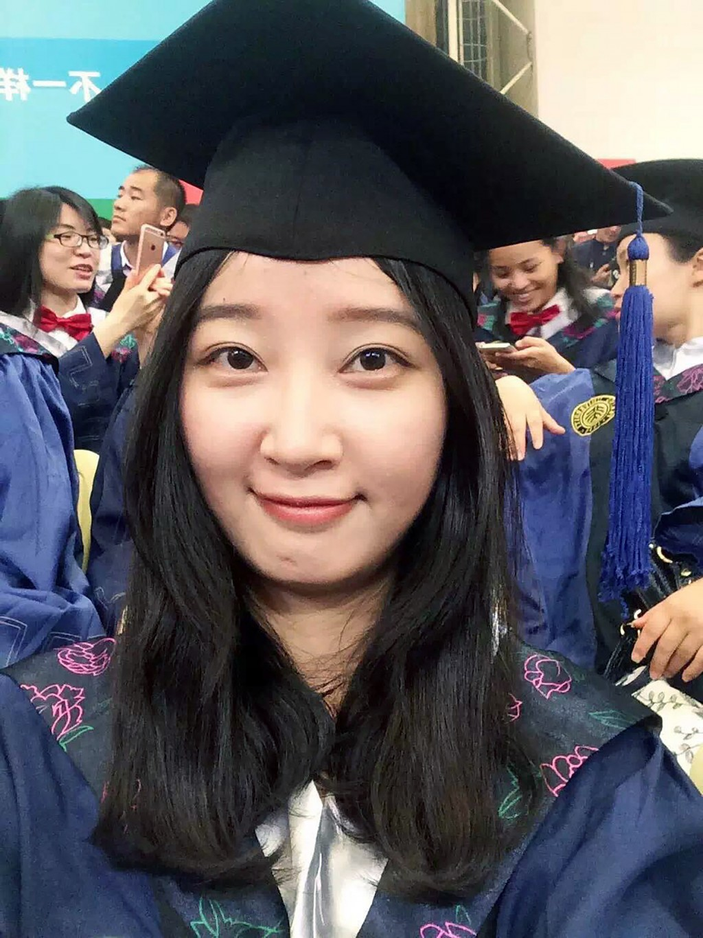 FILE - This 2016 selfie provided by her family shows Yingying Zhang in a cap and gown for her graduate degree in environmental engineering from Peking