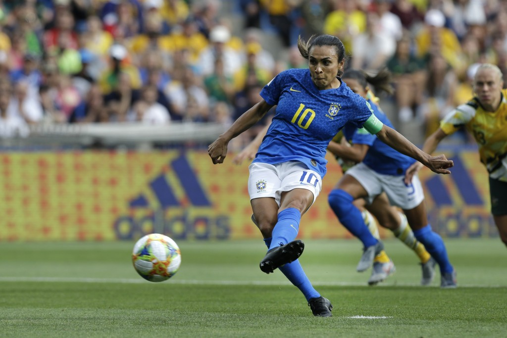 Brazil's Marta shoots a penalty kick to score the ...