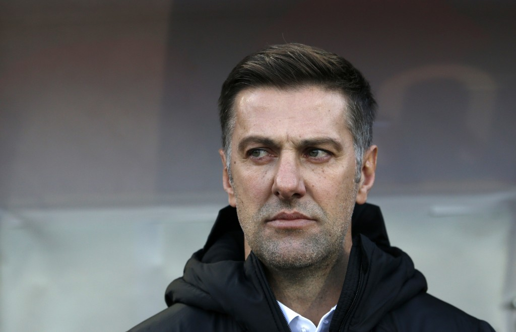 In this Saturday Nov. 17, 2018, Serbia coach Mladen Krstajic looks out from the bench prior the UEFA Nations League soccer match between Serbia and Mo