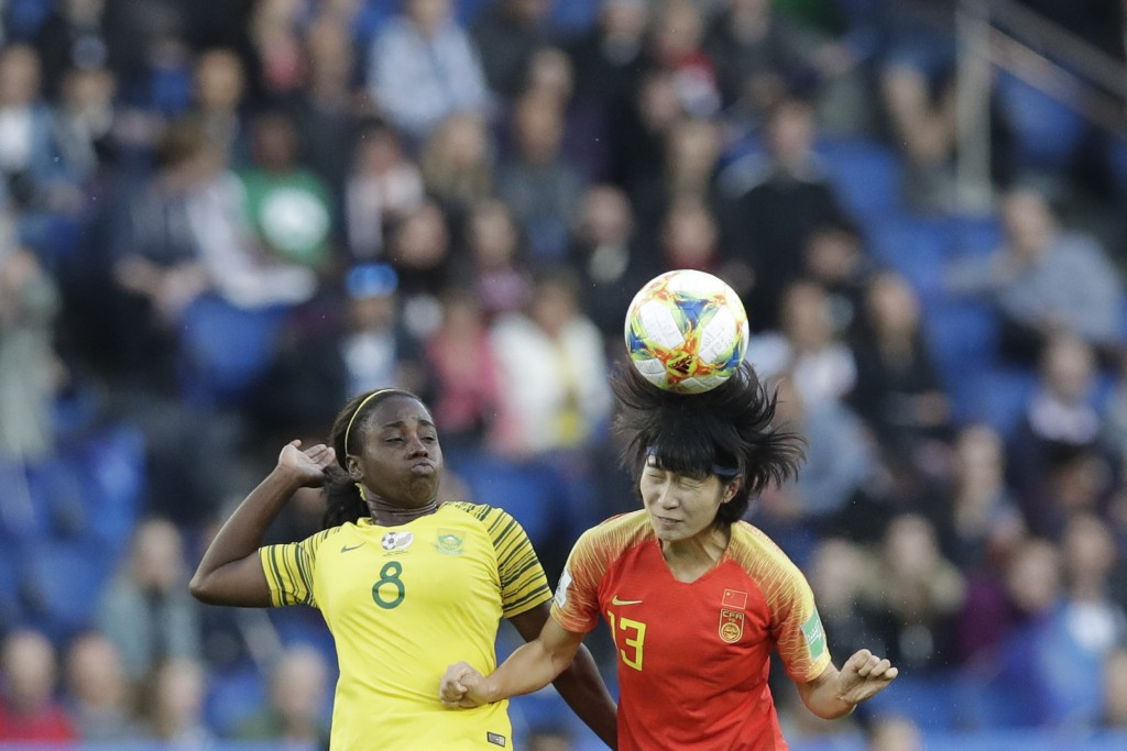 China's Wang Yan, right, heads the ball next to South Africa's Ode Fulutudilu during the Women's World Cup Group B soccer match between China and Sout
