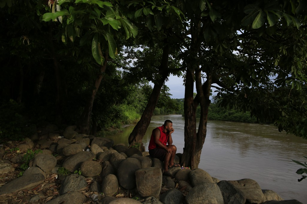 A local resident relaxes beside the Suchiate river in Frontera Hidalgo, Mexico, on the border with Guatemala, Thursday, June 13, 2019. Mexico announce