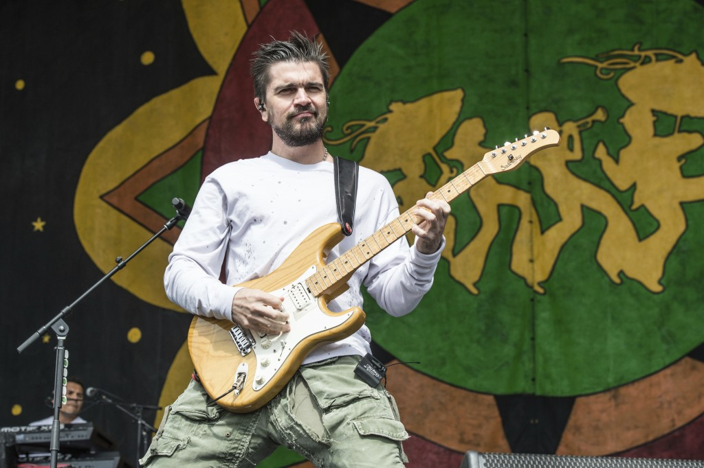 FILE - In this May 5, 2018 file photo, Juanes performs at the New Orleans Jazz and Heritage Festival in New Orleans. Juanes has been named 2019 Latin