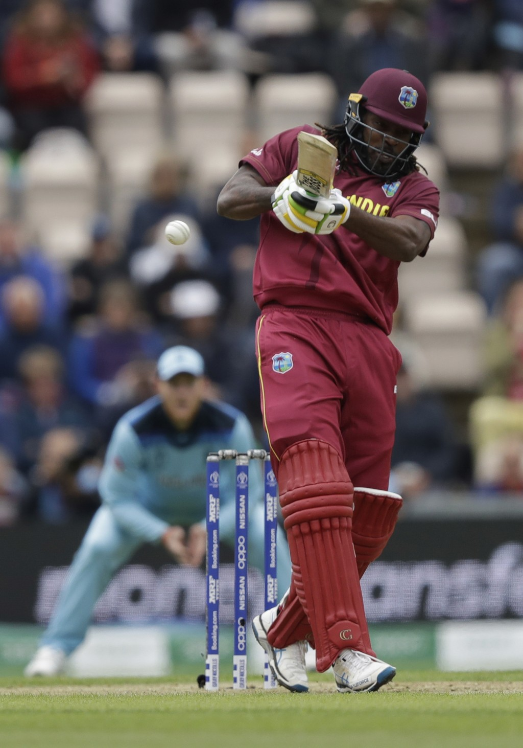 West Indies' Chris Gayle hits a four during the Cricket World Cup match between England and West Indies at the Hampshire Bowl in Southampton, England,