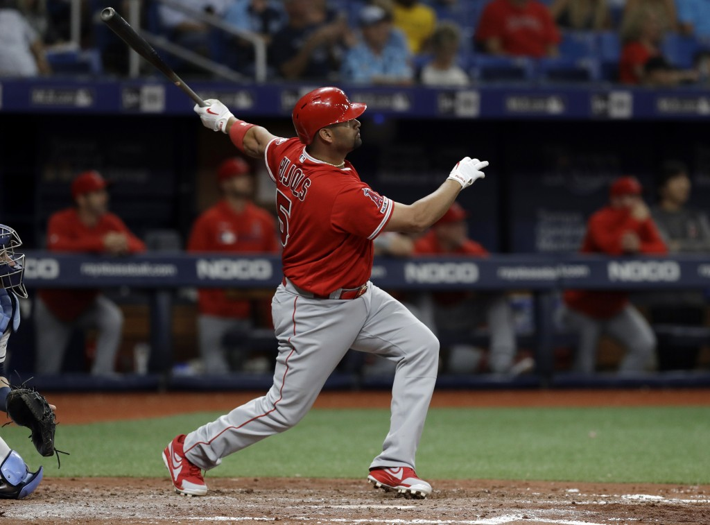 Los Angeles Angels' Albert Pujols watches his two-run home run off Tampa Bay Rays' Ryan Yarbrough during the fifth inning of a baseball game Thursday,