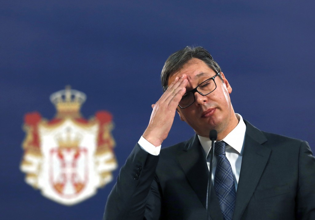 FILE - In this Sunday, Oct. 29, 2017 file photo, Serbian President Aleksandar Vucic gestures during a news conference in Belgrade, Serbia. Serbia's le