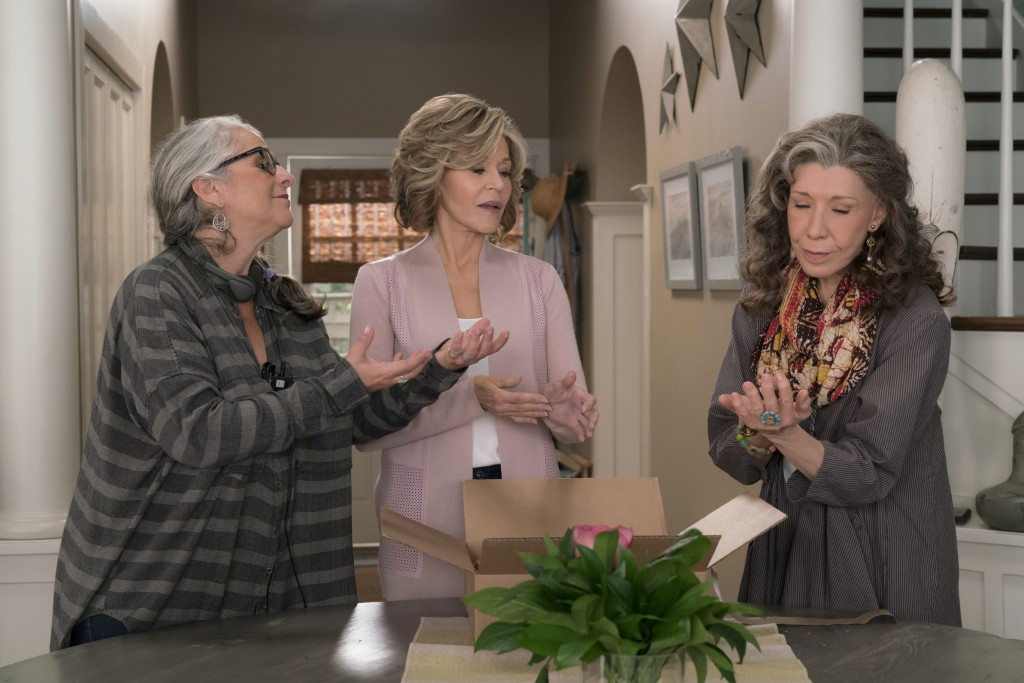 This 2016 photo provided by Netflix shows writer/producer Marta Kauffman, from left, Jane Fonda, as Grace Hanson, and Lily Tomlin, as Frankie Bergstei