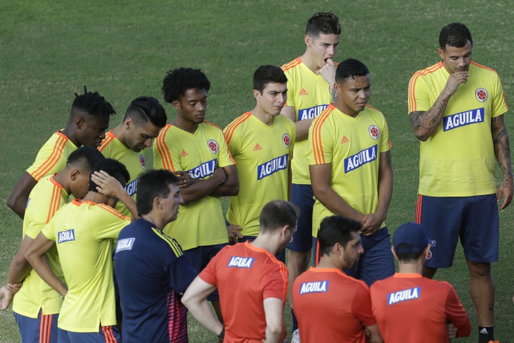 Colombia's James Rodriguez, third left, attends a training session with his teammates of the national soccer team, in Pituacu stadium, in Salvador, Br