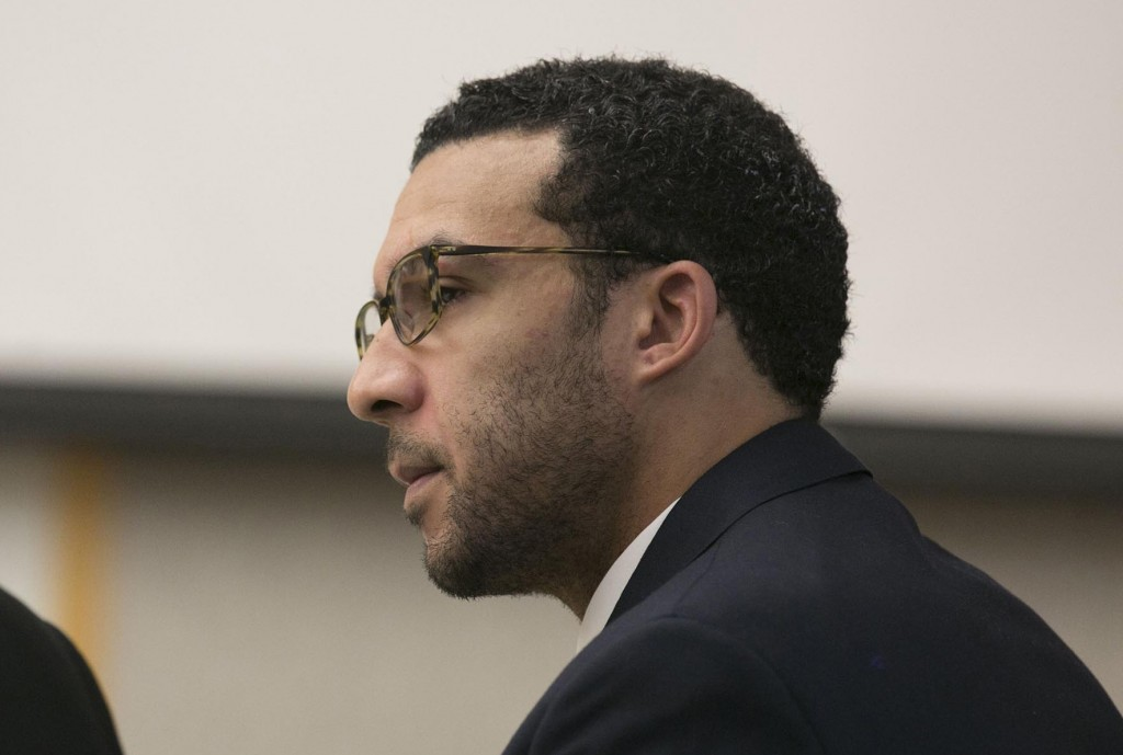 FILE - In this May 20, 2019 file photo Former NFL football player Kellen Winslow Jr. looks at attorney Marc Carlos during his rape trial in Vista, Cal